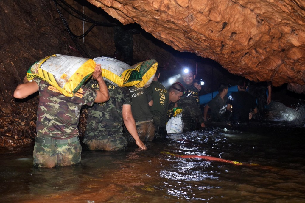 epa06858273 An undated handout photo released by Royal Thai Army on 02 July 2018 shows Thai soldiers carrying equipments inside the flooded cave complex during a rescue operation for a missing youth soccer team and their coach at Tham Luang cave in Khun Nam Nang Non Forest Park, Chiang Rai province, Thailand. Rescuers are attempting to pump water out of a cave complex in an effort to continue the rescue of 13 young members of a youth soccer team including their coach that are believed to have been trapped in the flooded cave complex since 23 June 2018. EPA/ROYAL THAI ARMY HANDOUT EDITORIAL USE ONLY/ NO SALES HANDOUT EDITORIAL USE ONLY/NO SALES